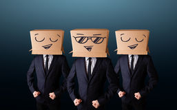 Men in suit gesturing with drawn smiley faces Stock Image