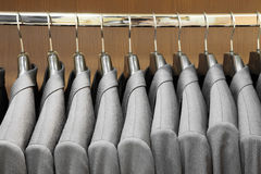 Men suit jackets in apparel store. Row of men suit jackets in apparel store Stock Photo