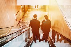 4 men in suit in the shopping center or buisnes center. Royalty Free Stock Photo