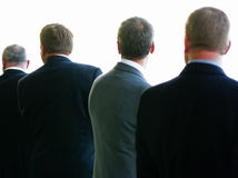 Men in Suits. Broad shouldered and well groomed men with backs to the camera Stock Images