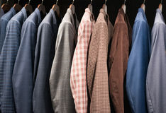 Men suits in a fashion store Royalty Free Stock Images