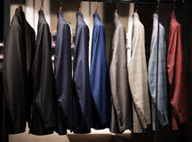 Men suits in a fashion store Royalty Free Stock Image