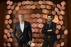 Men in suits. On a red bokeh background Stock Image