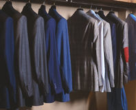 Men suits in a retail store royalty free stock photography