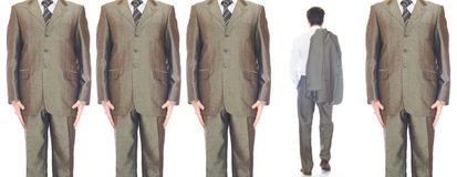 Men in suits. In the row and one go out Stock Images
