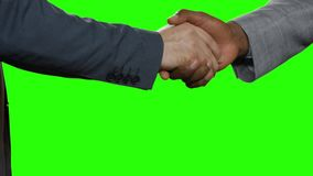 Men in suits shaking hands. Handshake on background hromakey. Start of partnership. Sign of mutual respect. Value the friendship stock video footage
