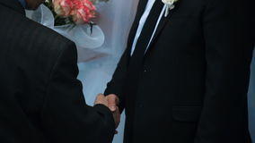 Men in suits shaking hands stock video