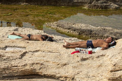Men sunbathing, Lebanon Royalty Free Stock Images
