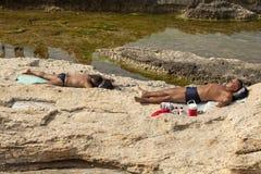 Men sunbathing, Lebanon Royalty Free Stock Images