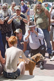 Men Surround a Topless Young Woman at a Go Topless Rally in Ashe Royalty Free Stock Images