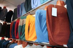Men sweater (jacket) on a shelf in the store Stock Photography