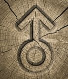 Men symbol. Male sex signs on wooden background. carved into the wood Royalty Free Stock Photography