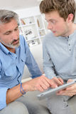 Men with tablet in house Stock Photos