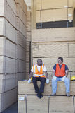 Men taking break from work in warehouse Stock Photography