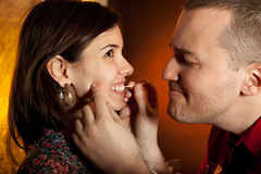 Men taking care of girlfriend's teeth Royalty Free Stock Image