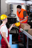 Men taking care about safety at warehouse Stock Photography