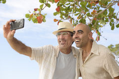 Men taking a selfie with mobile phone Royalty Free Stock Photos