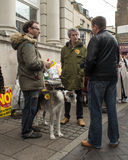 Men talking at Anti UKIP market stall in Thanet South. Men with dog at an Anti UKIP and Farage busy stall in Ramsgate, Thanet South during the General Election Stock Image