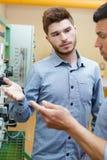 Men talking next to control panel royalty free stock photos