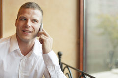 Men talking on phone Stock Photography