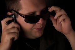 Men talking on telephone. Stock Images