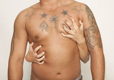 Men tattoos body. A young women presses dreamily on a man's chest royalty free stock image