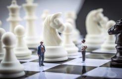 Men thumbnail within a game of chess Stock Photo
