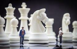 Men thumbnail within a game of chess Royalty Free Stock Photos