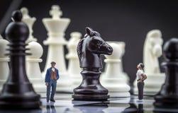 Men thumbnail within a game of chess Stock Photos