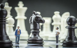 Men thumbnail within a game of chess Royalty Free Stock Photo