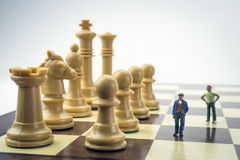 Men thumbnail within a game of chess Royalty Free Stock Images