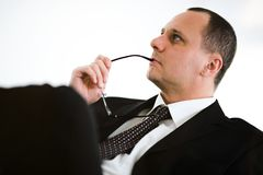 Men with tie on chair Royalty Free Stock Photo