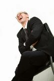 Men with tie in glasses on chair Royalty Free Stock Photo
