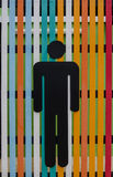 Men toilet sign. Black steel men toilet sign on colorful wooden wall Royalty Free Stock Photo