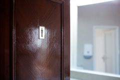 Men toilet sign. On a wooden door Stock Photos
