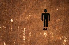 Men Toilet Sign on wooden door. Men Public Toilet Sign on a wooden door Royalty Free Stock Images