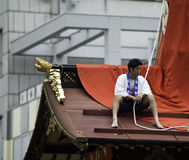 Men at the top of Float during Gion Matsuri Stock Photos