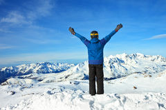 Men at the top of a snowy mountain with his hands Royalty Free Stock Photo
