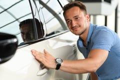 Men touching new car. stock photos