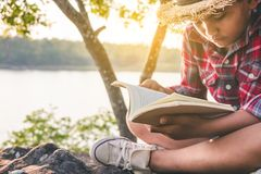 Men tourists education read book. Men tourists education read book in quiet nature stock photo