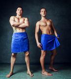 Men with towels Stock Images