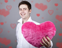 Men with toy heart. Stock Photography