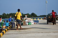 Men trade in a wide variety of sales at Sebesi Docks in Lampung, in Indonesia. SEBESI, BANDAR LAMPUNG, INDONESIA. JULY, 10 2018 : Unidentified Men trade in a Stock Image