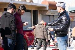 Men Trading in Iraq. Men buying stuff on the streets of Iraq paying in Iraqi Dinars royalty free stock photos