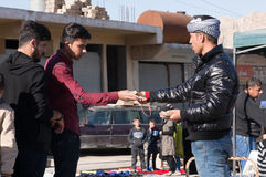 Men Trading in Iraq. Men buying stuff on the streets of Iraq paying in Iraqi Dinars Royalty Free Stock Photography