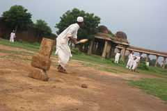Men in traditional attire play cricket, Sarkhej Roza Royalty Free Stock Images