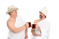 Men in traditional bathing attire drink kvas Stock Photos