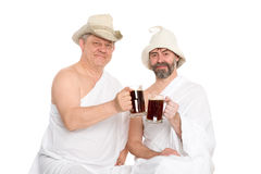 Men in traditional bathing attire drink kvas Stock Images