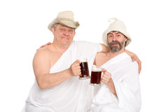 Men in traditional bathing costumes drink kvas Royalty Free Stock Photo