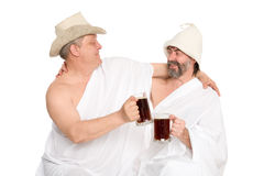 Men in traditional bathing costumes drink kvas Royalty Free Stock Photos